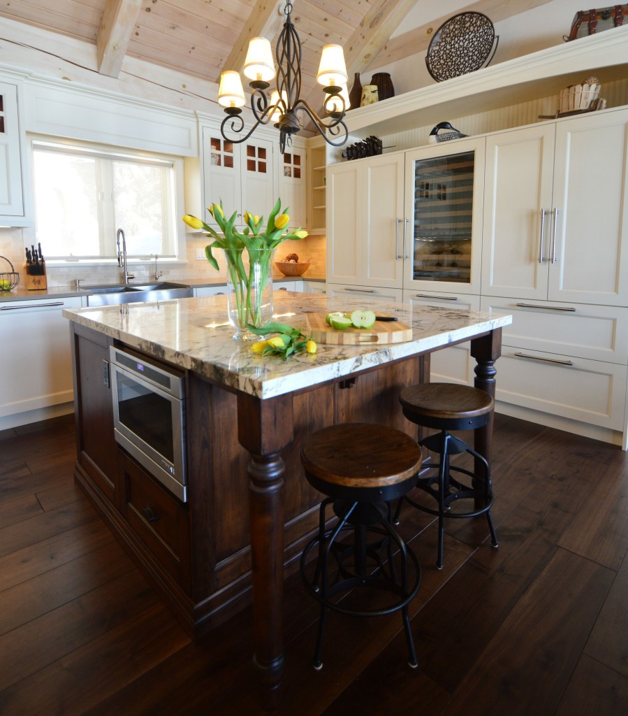 The off white/dark wood cabinetry combination give this cottage kitchen a cozy feel.