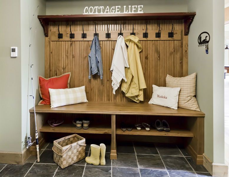 Keep your Muskoka cottage entrance organized with a custom bench that accommodates any busy lifestyle.