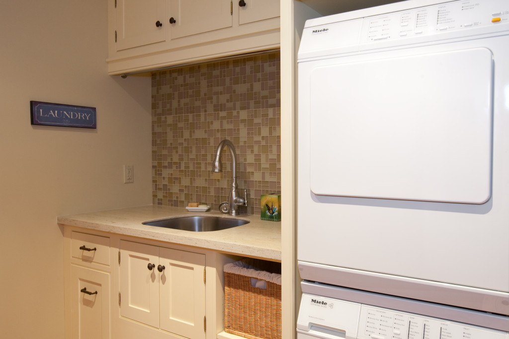 Keep the laundry room organized with functional upper and lower storage for all the cleaning essentials!