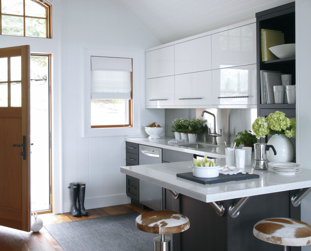 A clean line, contemporary kitchen mixing crisp whites and dark wood cabinets.