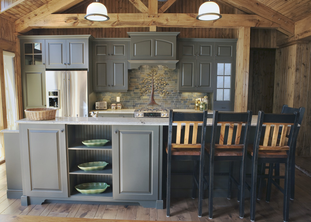Rustic woods and a dark finish on the cabinetry bring this cabin cottage kitchen to life.