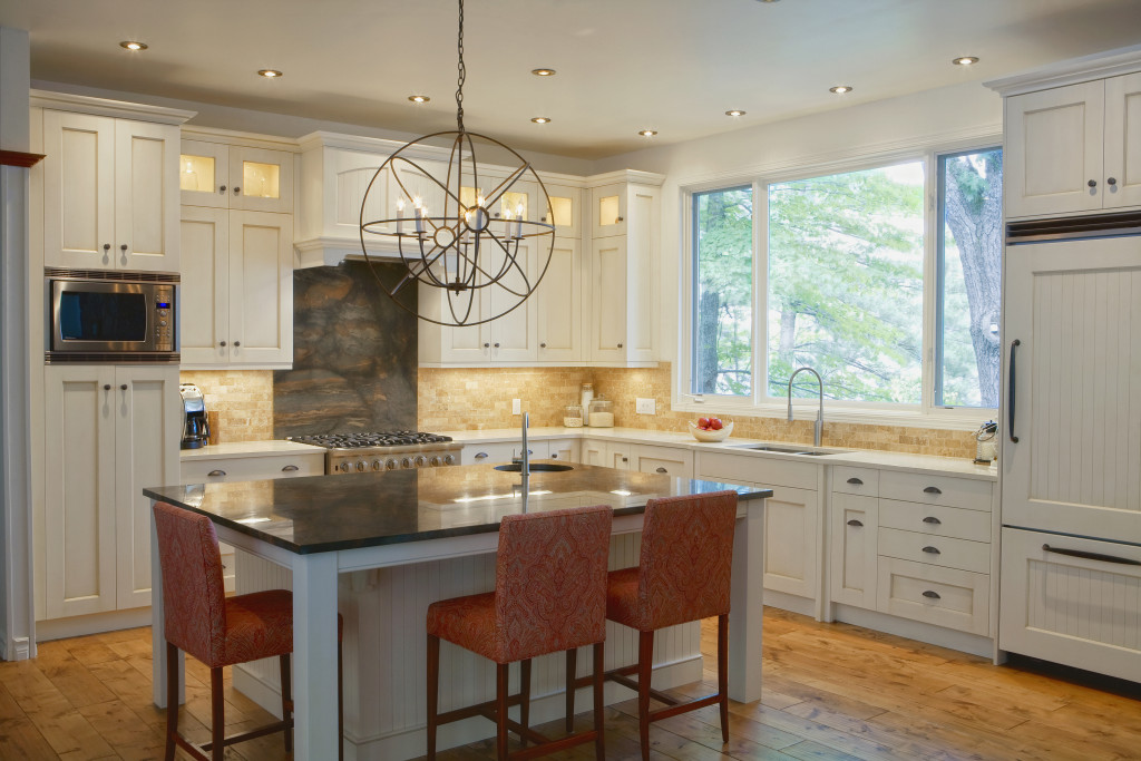 Crisp white on white cabinets/counters combination on the perimeter with contrasting dark counters on the island.