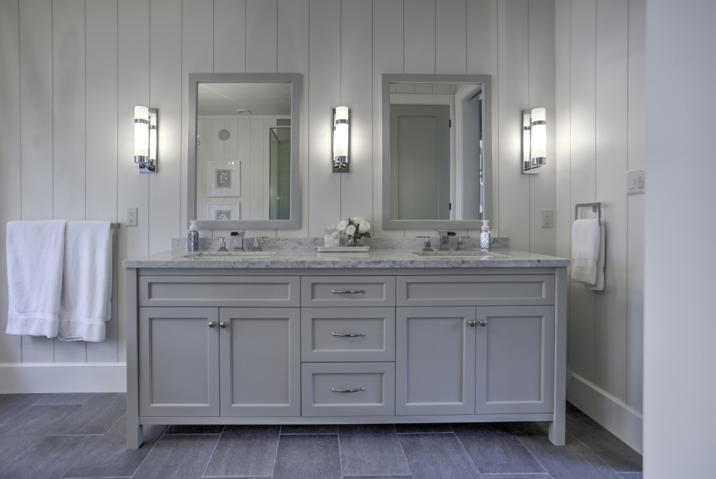 This calm and serene master bath features warm grey toned vanity cabinets with a complemeting granite countertop.